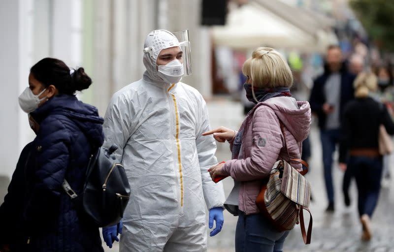 People wait to be tested for the coronavirus disease in Prague
