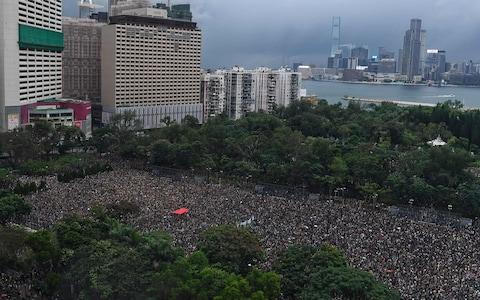Protesters gather for a rally in Victoria Park in Hong Kong on Sunday - Credit: AFP