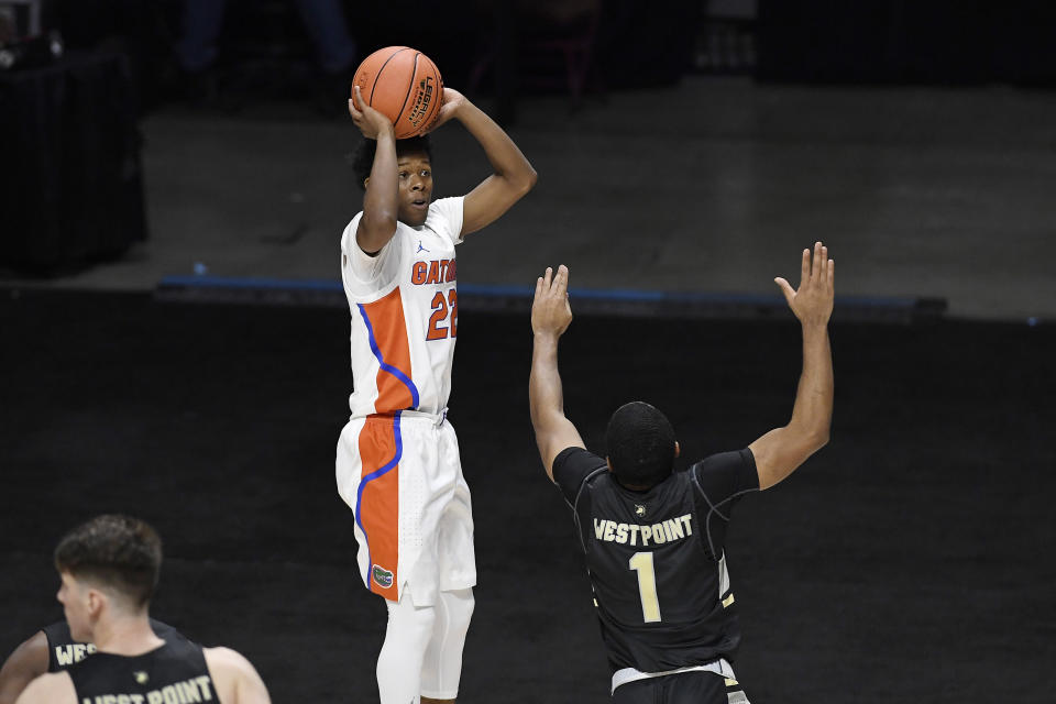 Florida's Tyree Appleby makes a basket over Army's Jalen Rucker in the second half of an NCAA college basketball game, Wednesday, Dec. 2, 2020, in Uncasville, Conn. (AP Photo/Jessica Hill)
