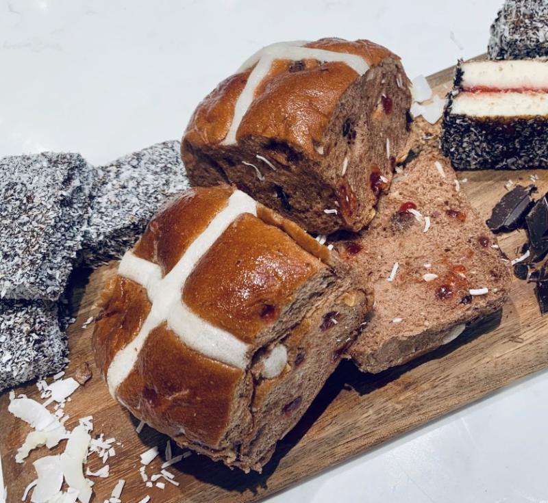 Coles lamington hot cross buns on a board with lamingtons