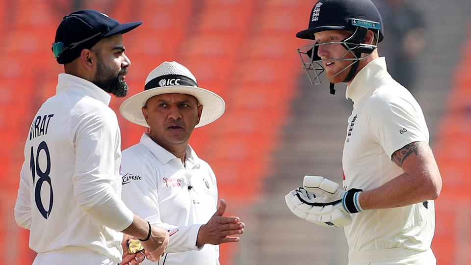 Virat Kohli and Ben Stokes, pictured here being separated by umpire Virender Sharma.
