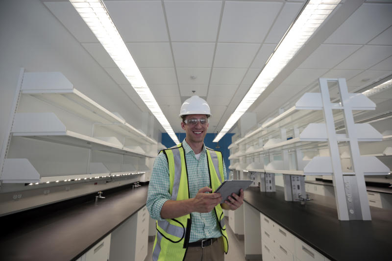 "Drew Miller, poses for a photograph, at a building under construction, Wednesday, July 10, 2013 in Silver Spring, Md. Miller quit a steady government contract job to take a chance on a company that's using ""smart technologies"" to help big corporations cut lighting costs. (AP Photo/Alex Brandon)"