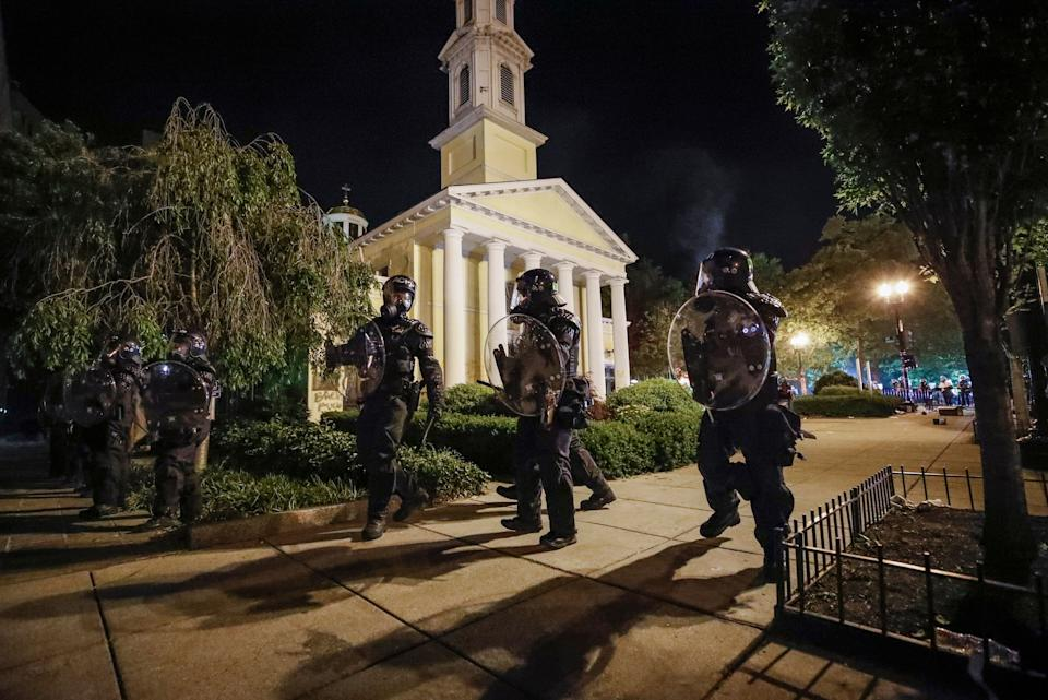 Police form a line in front of St. John's Episcopal Church on May 31, 2020, near the White House in Washington.  (Photo: ASSOCIATED PRESS)