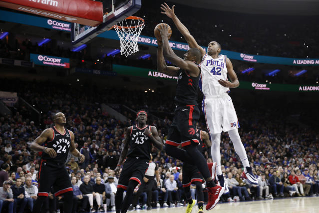Philadelphia 76ers' Al Horford (42) blocks a shot by Toronto Raptors' Serge Ibaka (9) during the first half of an NBA basketball game, Sunday, Dec. 8, 2019, in Philadelphia. (AP Photo/Matt Slocum)