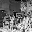 """<p>Shortly after Josephine's marriage to Jo Bouillon, the couple adopted their first child together. It wasn't long before the couple filled Château des Milandes with 12 children — of all different races, religions and ethnicities — which they called their """"Rainbow Tribe."""" Here, the family celebrates Christmas morning in the foyer. </p>"""
