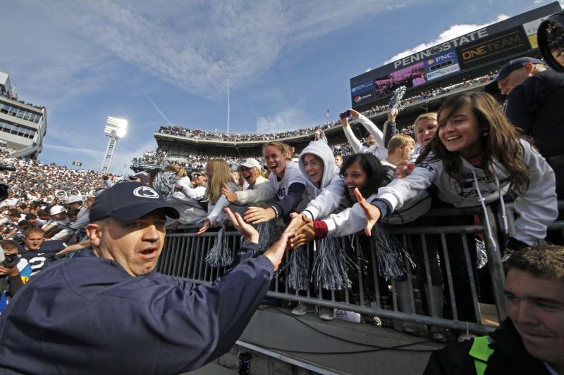 Penn State head coach Bill O'Brien, left, celebrates with students as he leaves the field at Beaver Stadium following a 39-28 win over Northwestern in an NCAA college football game in State College, Pa., Saturday, Oct. 6, 2012. (AP Photo/Gene J. Puskar)
