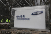 The logo of the Samsung Electronics Co. is seen at its office in Seoul, South Korea, Thursday, Jan. 28, 2021. Samsung Electronics Co. said Thursday its operating profit for last quarter rose by more than 26% as it capped off a robust business year where its dual strength in parts and finished products allowed it to thrive amid the pandemic. (AP Photo/Ahn Young-joon)