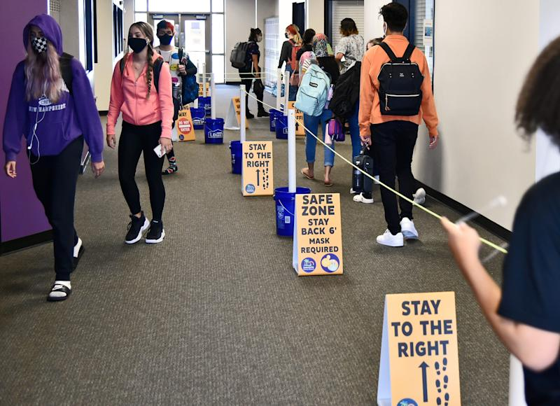 Students change classes recently at Booker High School in Sarasota, Fla., where measures have been taken across the campus to facilitate social distancing.