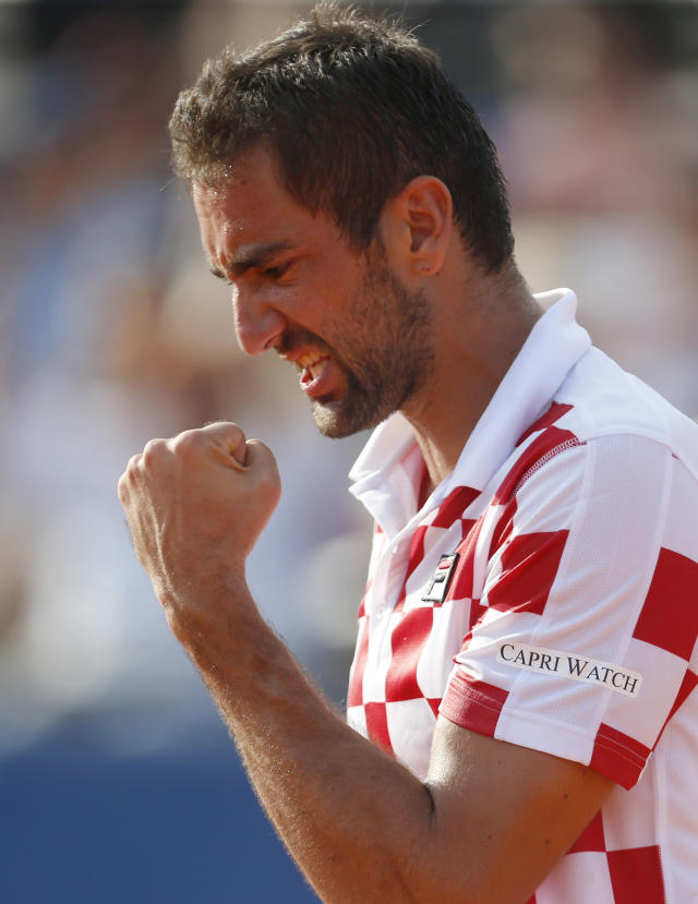 Marin Cilic of Croatia celebrates after defeating Frances Tiafoe of the United States during a Davis Cup semifinal singles match between Croatia and the United States in Zadar, Croatia, Friday, Sept. 14, 2018. (AP Photo/Darko Bandic)