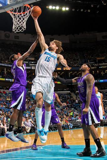 NEW ORLEANS, LA - FEBRUARY 24: Robin Lopez #15 of the New Orleans Hornets drives to the basket against John Salmons #5 and DeMarcus Cousins #15 of the Sacramento Kings on February 24, 2013 at the New Orleans Arena in New Orleans, Louisiana. (Photo by Layne Murdoch Jr./NBAE via Getty Images)