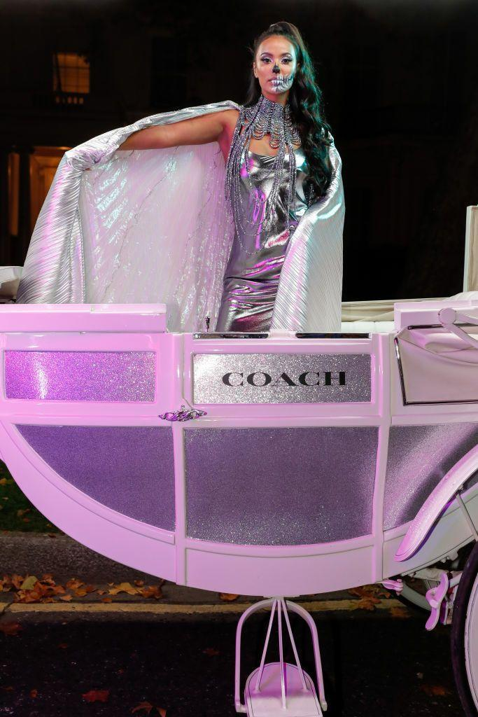 <p>The presenter and DJ sported a decadent Halloween look, complete with incredible make-up, to lead a surprise Halloween parade through central London via a Coach horse drawn carriage.</p>