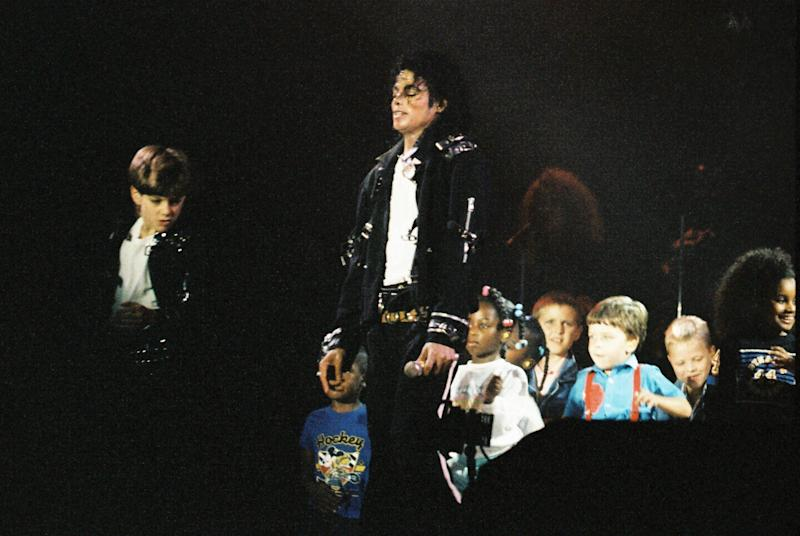 "Michael Jackson performing with children during his 1988 ""Bad"" tour. (Photo: Peter Still via Getty Images)"