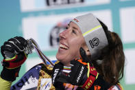 Silver medal Germany's Kira Weidle celebrates holds the silver medal after the women's downhill, at the alpine ski World Championships in Cortina d'Ampezzo, Italy, Saturday, Feb. 13, 2021. (AP Photo/Giovanni Auletta)