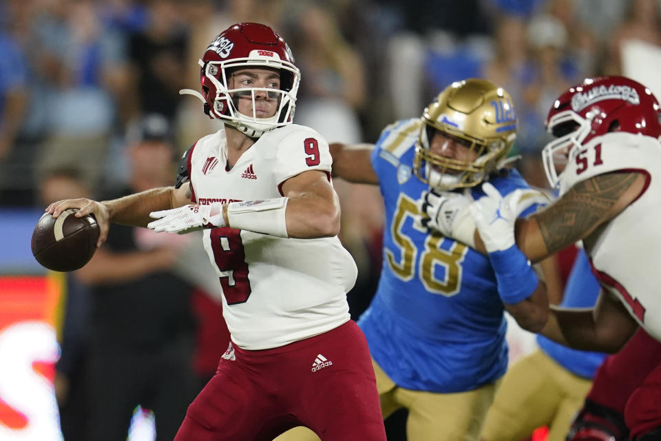 Fresno State quarterback Jake Haener looks for a receiver during the first half of the team's NCAA college football game against UCLA on Saturday, Sept. 18, 2021, in Pasadena, Calif. (AP Photo/Marcio Jose Sanchez)