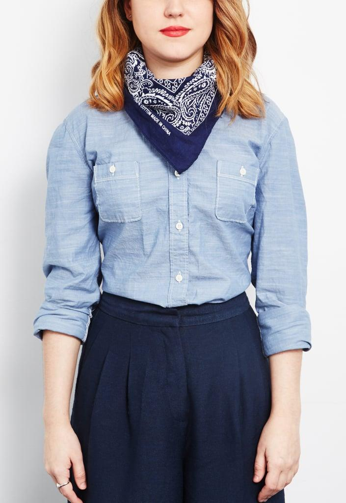 <p>Fold your bandanna in half so that the ends meet, then tie it around your neck.</p>
