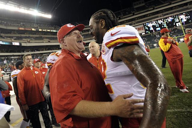 Kansas City Chiefs coach Andy Reid, left, and Dwayne Bowe celebrate in the final minutes of an NFL football game against the Philadelphia Eagles, Thursday, Sept. 19, 2013, in Philadelphia. Kansas City won 26-16. (AP Photo/Michael Perez)