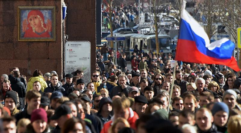 Protesters walk along Moscow's Tverskaya street during an unauthorised anti-corruption rally on March 26, 2017