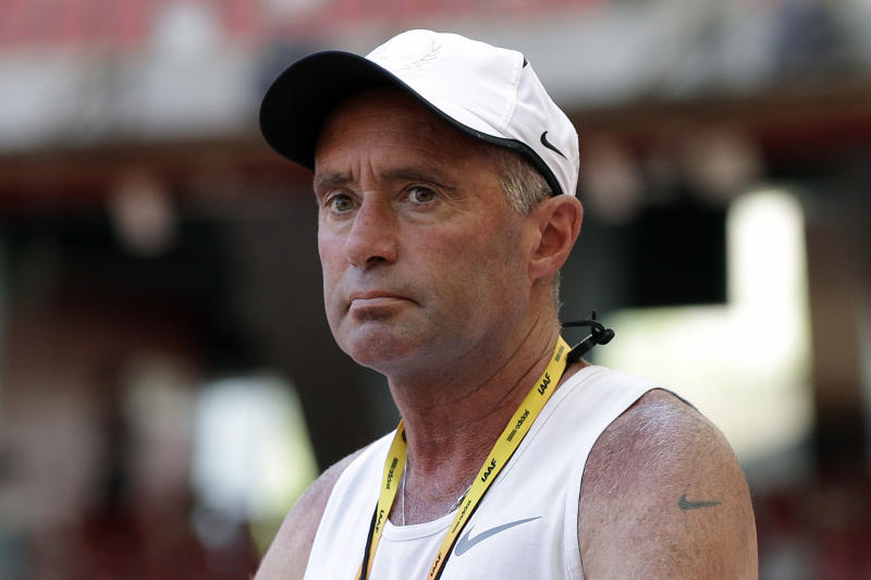 FILE - In this Aug. 21, 2015, file photo, Alberto Salazar watches a training session for the World Athletic Championships at the Bird's Nest stadium in Beijing. Salazar was excited about a performance-enhancing supplement he was trying out on his runners. The supplement ended up triggering a drawn-out investigation that led to Salazar's four-year suspension from track and field. (AP Photo/Kin Cheung, File)