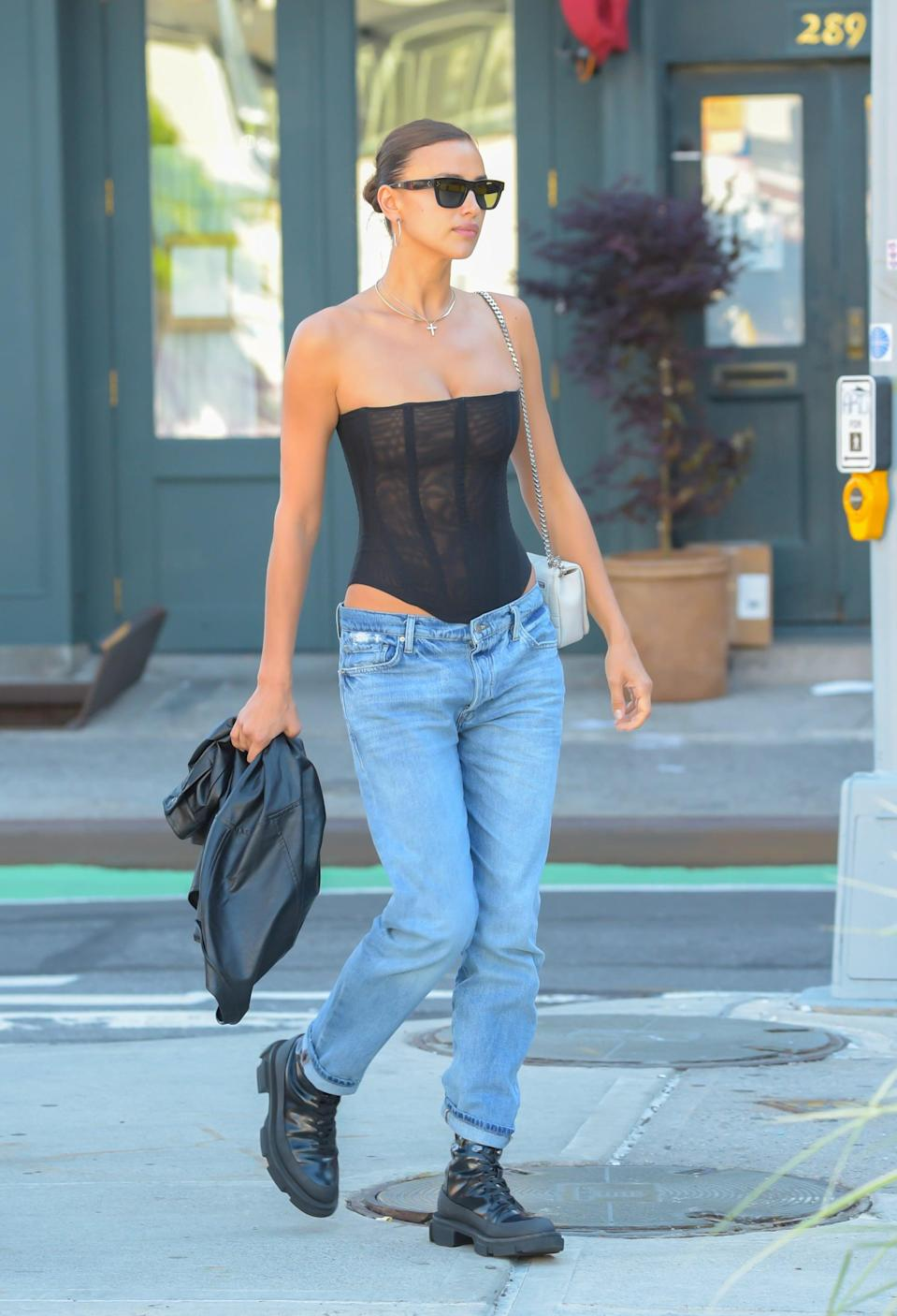 """<p>In <a href=""""https://www.popsugar.com/fashion/irina-shayk-corset-top-low-rise-jeans-outfit-48377172"""" class=""""link rapid-noclick-resp"""" rel=""""nofollow noopener"""" target=""""_blank"""" data-ylk=""""slk:an outfit"""">an outfit</a> that looks to be straight from the 2000s. </p>"""