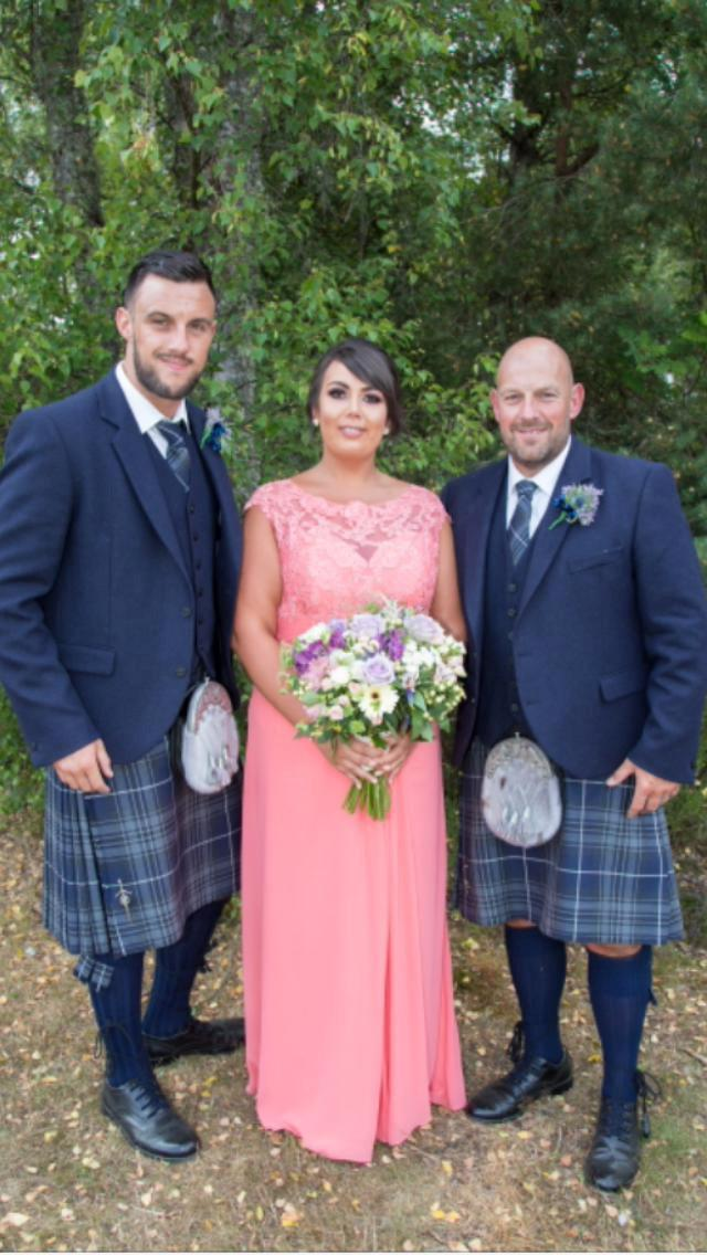 Danielle Richmond (middle) at her father's wedding, brother Darell (left) and father Gordon (right). [Photo: SWNS]