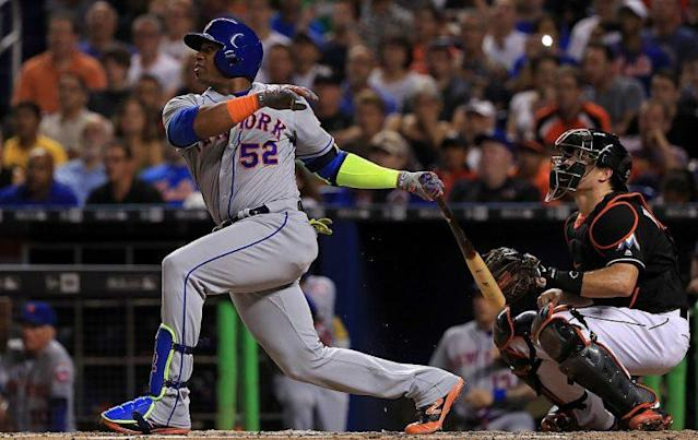 MIAMI, FL – JULY 23: Yoenis Cespedes #52 of the New York Mets hits an RBI single during a game against the Miami Marlins at Marlins Park on July 23, 2016 in Miami, Florida. (Photo by Mike Ehrmann/Getty Images)