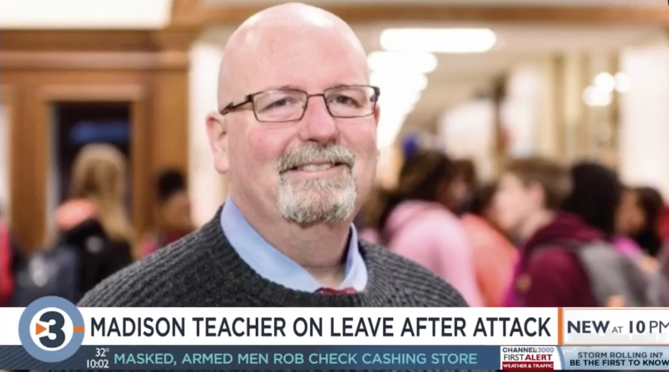 Rob Mueller-Owens, a teacher at Whitehorse Middle School in Madison, Wisconsin, allegedly tore a student's braids off her head after pushing and falling on top of her. (Screenshot: WISC-TV)