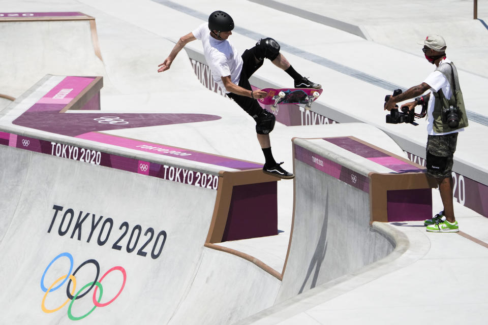 Tony Hawk who is not a competitor, tries out the skate park at the 2020 Summer Olympics, Friday, July 23, 2021, in Tokyo, Japan. (AP Photo/Markus Schreiber)