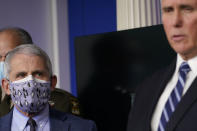 Dr. Anthony Fauci, director of the National Institute of Allergy and Infectious Diseases, left, listens as Vice President Mike Pence, right, speaks during a news conference with the coronavirus task force at the White House in Washington, Thursday, Nov. 19, 2020. (AP Photo/Susan Walsh)