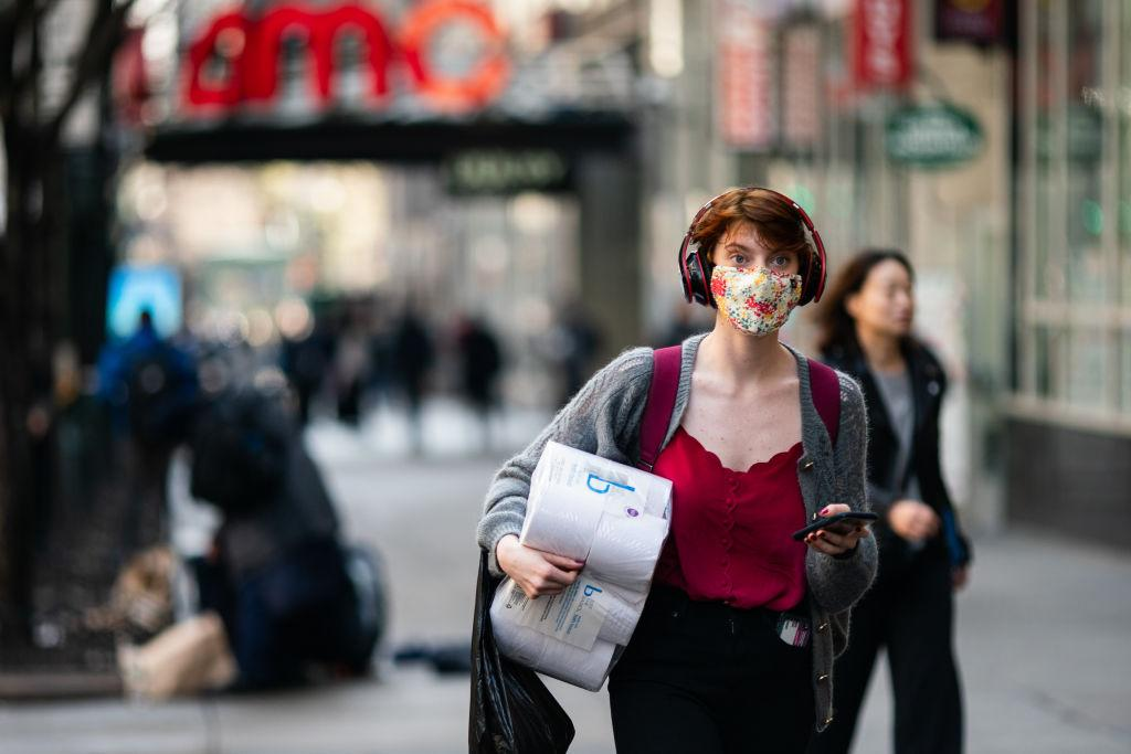 More people have taken to wearing non-medical face masks as an added precaution against spreading COVID-19. (Photo by Jeenah Moon/Getty Images)