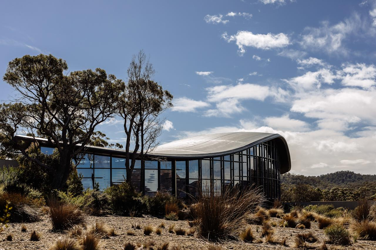 """<p><strong>Why did this hotel catch your attention? What's the vibe?</strong> Saffire sits, half-hidden in the landscape, perched on the east coast of Tasmania (call it Tassie, like the locals do). It's a good thing, too, as this side of the island is far drier and sunnier there than the dreary west coast, especially during April and May; the lodge is named after the gems which are found here, and almost nowhere else in Australia. The undulating, stingray-inspired roof of the main building glints in the sunshine, while the 20 individual suites are dotted among the greenery, artfully arranged to look like boats rimming the shoreline.</p> <p><strong>What's the backstory?</strong> More than 100 years ago, this area's natural beauty was important enough to earn it status as the island's first national park. That protection prevented much human encroachment, other than a small village and an RV park for vacationers. That changed a decade or so ago, when local casino magnates the Farrell family demolished the park and put more than A$30 million into building this ultra-luxe retreat in its stead. <a href=""""https://www.cntraveler.com/destinations/sydney?mbid=synd_yahoo_rss"""">Sydney</a>-based firm Chada designed the interiors to be homey and wood-heavy, incorporating local lumber like celery topped pine and Tasmanian oak.</p> <p><strong>Tell us all about the accommodations. Any tips on what to book?</strong> Forget the room—look out of the window. Every suite is carefully positioned to give soaring views out across Great Oyster Bay and the craggy Hazards mountain range: press a button to raise the shade without even emerging from your duvet. The standard category here is called a luxury suite, but it's well worth spending A$300 more for the so-called signature suite, which has an al fresco deck and a bathroom with jaw-dropping views, too. The plushest option, though, is one of four private pavilions, each of which includes an onsite kitchen plus a private plunge pool. Each roo"""