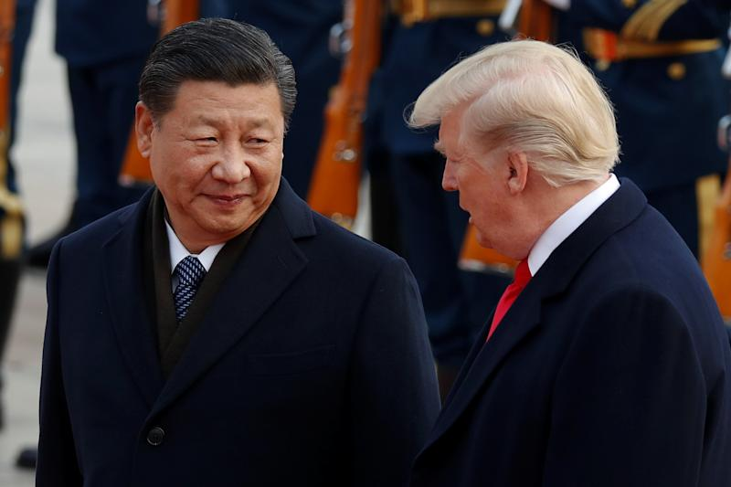 U.S. President Donald Trump takes part in a welcoming ceremony with China's President Xi Jinping. (Damir Sagolj / Reuters)