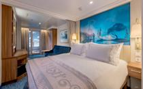 <p>Most of the ship's 1,254 staterooms will offer an ocean view, including 877 (70%) with a spacious verandah. (Disney)</p>