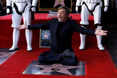 Actor Hamill poses on his star after it was unveiled on the Hollywood Walk of Fame in Los Angeles