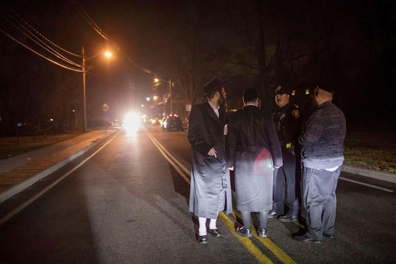 Witnesses talk to police after the stabbing at a rabbi's house in Monsey, New York | Allyse Pulliam/AP/Shutterstock