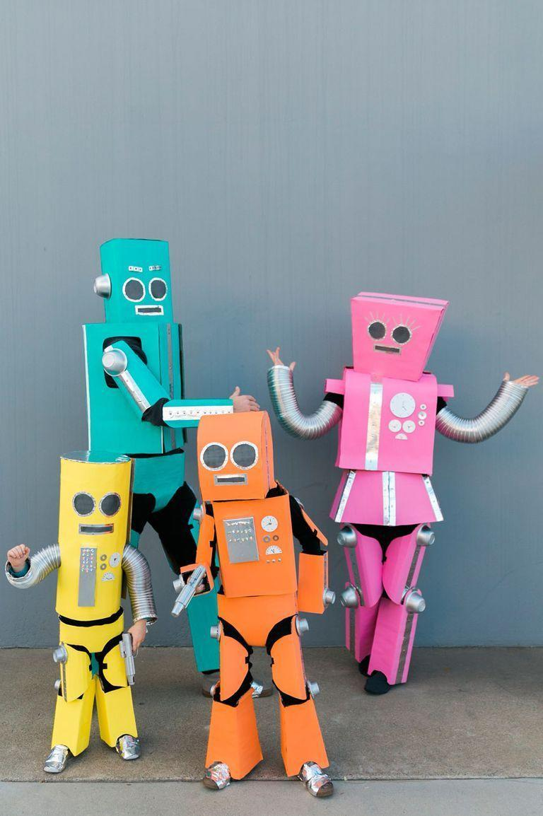 """<p>We know that there are four people here, but you can always go as robots in your party of three. Just grab some duct tape, aluminum flex pipes, and foil tape before you DIY!</p><p><a class=""""link rapid-noclick-resp"""" href=""""https://www.amazon.com/Duck-394468-All-Purpose-Inches-Silver/dp/B0006HX2MK/ref=sr_1_3?tag=syn-yahoo-20&ascsubtag=%5Bartid%7C10055.g.28073110%5Bsrc%7Cyahoo-us"""" rel=""""nofollow noopener"""" target=""""_blank"""" data-ylk=""""slk:SHOP DUCT TAPE"""">SHOP DUCT TAPE</a></p><p><a class=""""link rapid-noclick-resp"""" href=""""https://www.amazon.com/Speedi-Products-EX-AF-8120-Diameter-Aluminum/dp/B0085UZJZS/ref=sr_1_3?tag=syn-yahoo-20&ascsubtag=%5Bartid%7C10055.g.28073110%5Bsrc%7Cyahoo-us"""" rel=""""nofollow noopener"""" target=""""_blank"""" data-ylk=""""slk:SHOP ALUMINUM FLEX PIPES"""">SHOP ALUMINUM FLEX PIPES</a></p><p><a class=""""link rapid-noclick-resp"""" href=""""https://www.amazon.com/Aluminum-Tape-Foil-Ducts-Insulation/dp/B01FROBUXE/ref=sr_1_1_sspa?tag=syn-yahoo-20&ascsubtag=%5Bartid%7C10055.g.28073110%5Bsrc%7Cyahoo-us"""" rel=""""nofollow noopener"""" target=""""_blank"""" data-ylk=""""slk:SHOP FOIL TAPE"""">SHOP FOIL TAPE</a></p><p><em><a href=""""https://tellloveandparty.com/2017/09/diy-robot-family-costume.html"""" rel=""""nofollow noopener"""" target=""""_blank"""" data-ylk=""""slk:Get the tutorial at Tell Love and Party »"""" class=""""link rapid-noclick-resp"""">Get the tutorial at Tell Love and Party »</a></em></p>"""