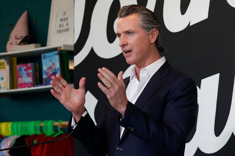 Gov. Gavin Newsom discusses his plan for the gradual reopening of California businesses during a news conference at the Display California store in Sacramento, Calif. Newsom on Wednesday.
