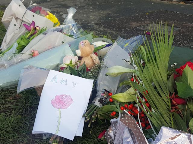 Floral tributes left for the victims in Hazel Way, Crawley Down, West Sussex. (PA)