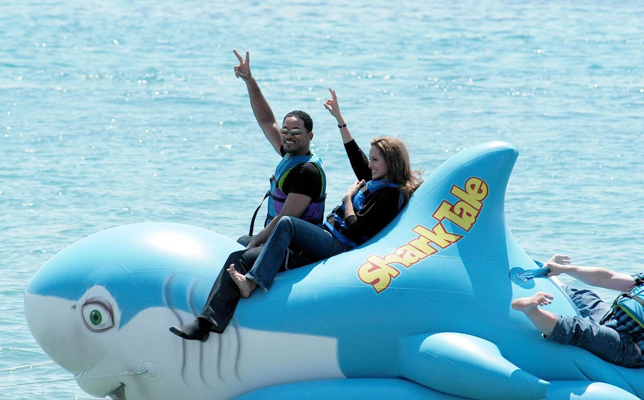 <p>Smith voiced Oscar in the 2004 film <em>Shark Tale</em>. Here he is with his co-star Angelina Jolie on a giant promotional blow-up shark at the Cannes Film Festival that year. <em></em> </p>