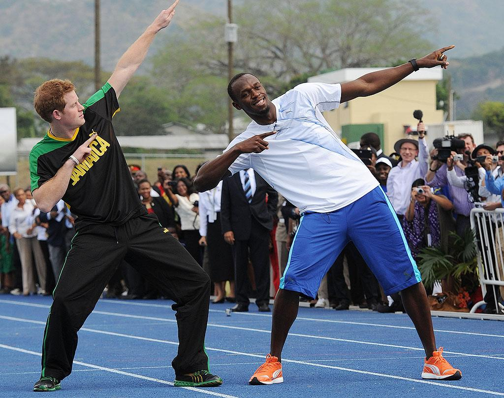 Prince Harry also met with legendary sprinter and Olympic gold medalist Usain Bolt at the University of the West Indies, also in Kingston ... and the duo drew quite a crowd! What do you think of Harry's attempt at emulating Bolt's signature lightning pose? (3/6/2012)