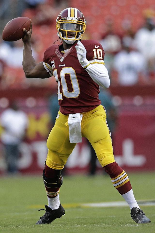 Washington Redskins quarterback Robert Griffin III warms up before an NFL football game against the Philadelphia Eagles in Landover, Md., Monday, Sept. 9, 2013. (AP Photo/Patrick Semansky)