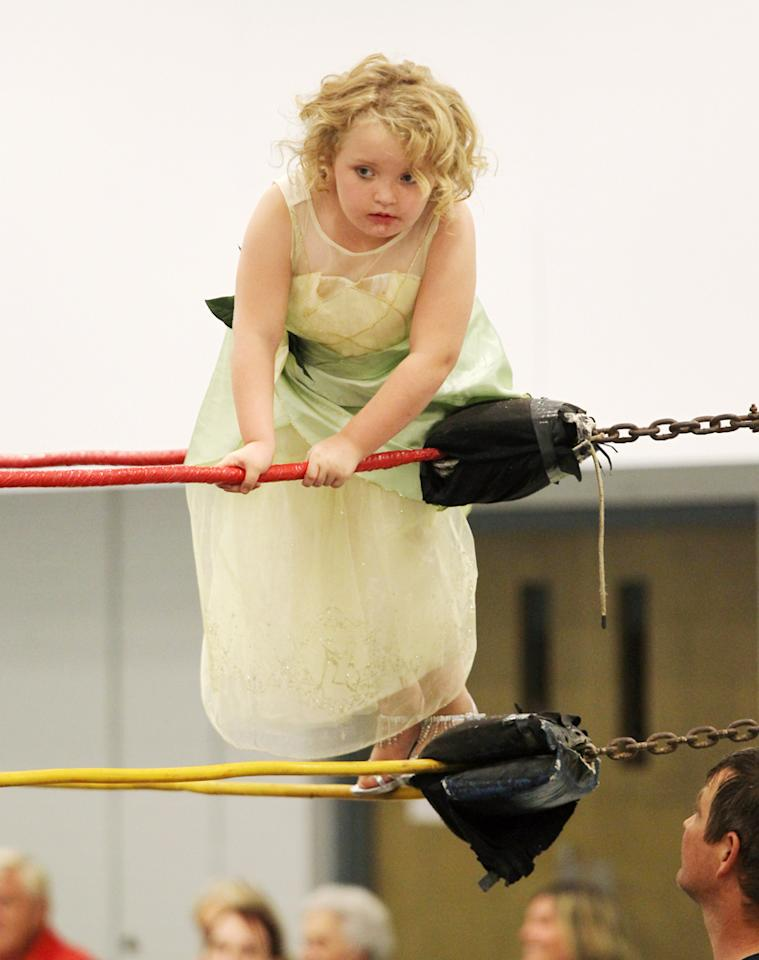 Who's ready to rumble? Honey Boo Boo -- who looked more like Tinkerbell than a WWE star -- while hanging out on the ropes. (10/9/12)<br>