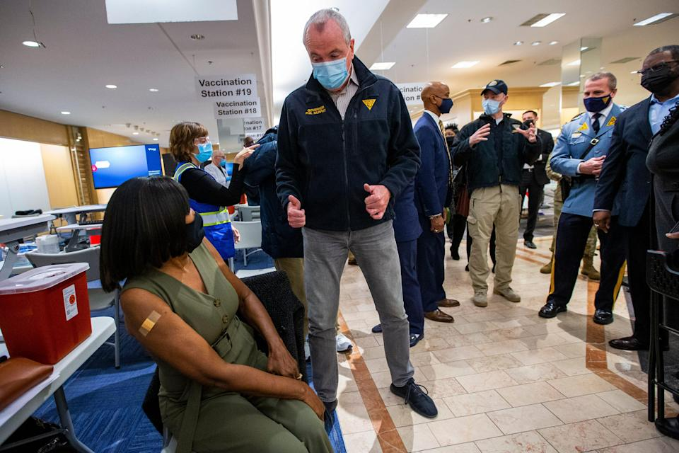 New Jersey Gov. Phil Murphy gives a thumbs-up to a resident getting vaccinated at the Burlington County mega-site inside the former Lord & Taylor at Moorestown Mall on Friday morning.