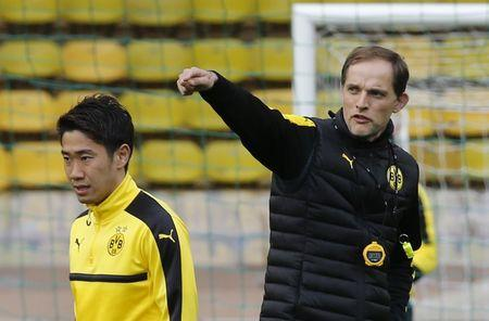 Borussia Dortmund coach Thomas Tuchel and Shinji Kagawa during training