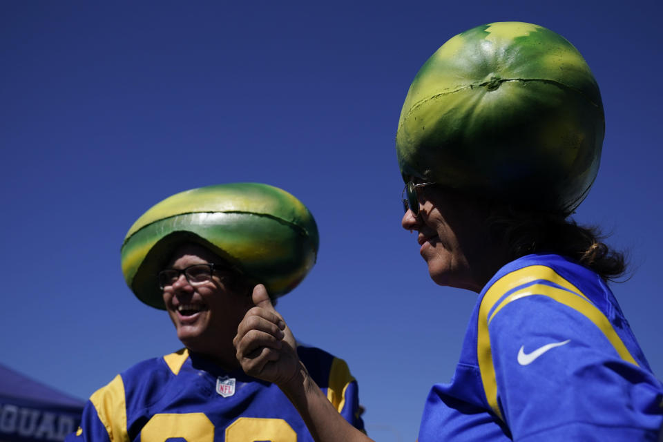Fans for the Los Angeles Rams tailgate before an NFL football game against the Chicago Bears at SoFi Stadium Sunday, Sept. 12, 2021, in Inglewood, Calif. (AP Photo/Jae C. Hong)