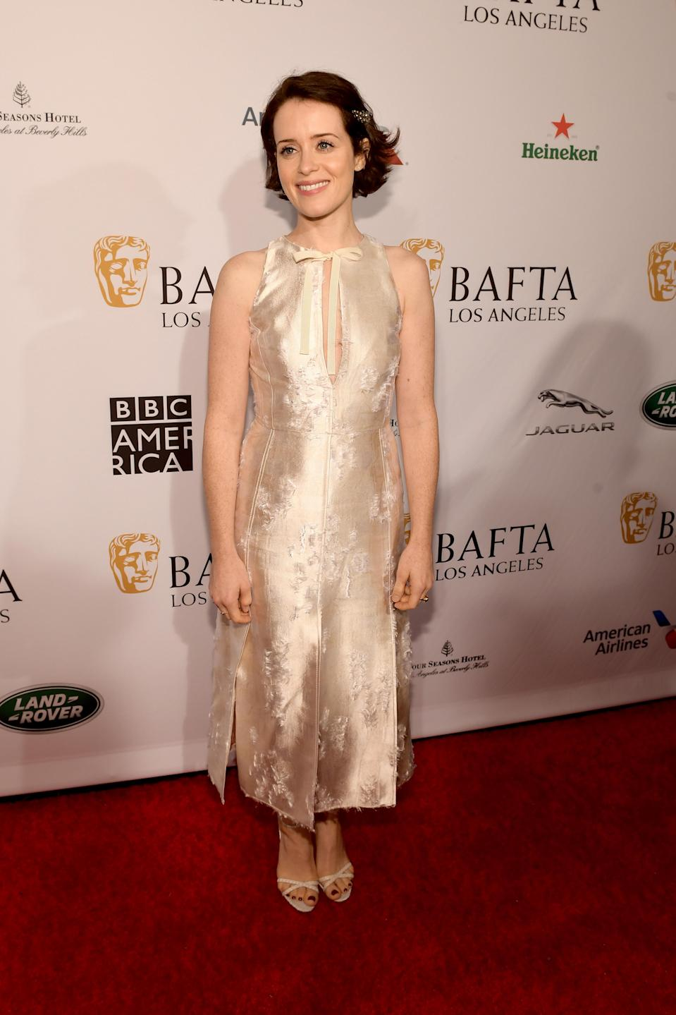 <p>Claire Foy wore Altuzarra's SS19 'Margherita' dress in silk jacquard to attend the BAFTA Los Angeles Tea Party on January 5. <em>[Photo: Getty]</em> </p>