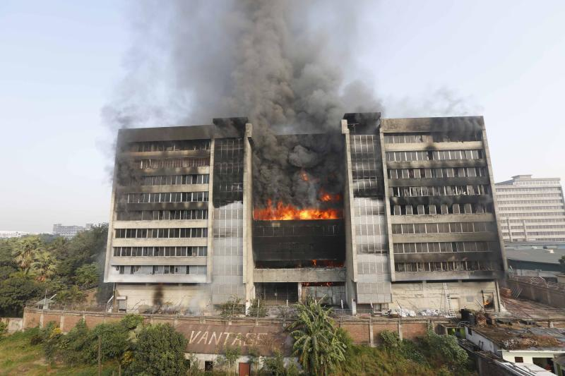 Smoke rises from a fire burning at a Standard Group garment factory in Gazipur