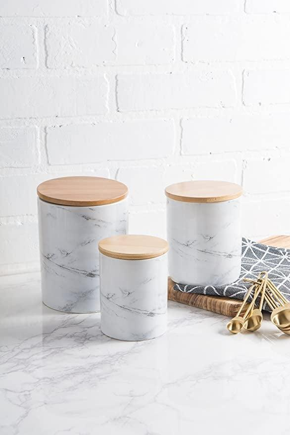 <p>If you have modern tastes, you might appreciate the <span>DII 5119 3-Piece Modern Ceramic Kitchen Canister with Airtight Bamboo Lid</span> ($27)</p>