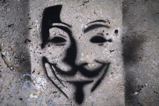 This file photo shows an image on a wall, representing Anonymous Guy Fawkes mask. On Wednesday, the Anonymous forum fired an opening shot by attacking the website of India's state-run telecom provider MTNL, pasting the logo of the group -- the mask of 17th century revolutionary Fawkes