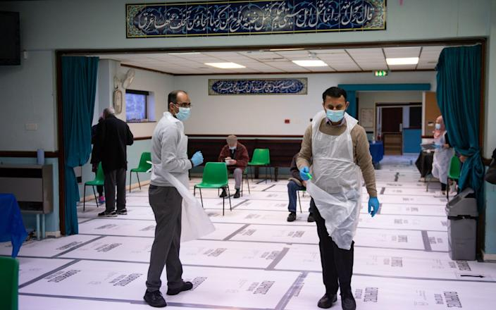 Pharmacists at the Al Abbas Mosque, Birmingham, which is being used as a covid vaccination centre - Jacob King/PA Wire