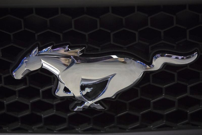 The Mustang logo is seen on the grill of new 2015 Ford Mustang GT during the Ford Motor Co. unveil event in New York
